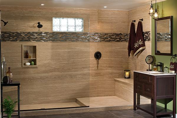 Large walk-in stone shower with custom glass and Bertch vanity.