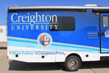 Completed bus wrap for Creighton University