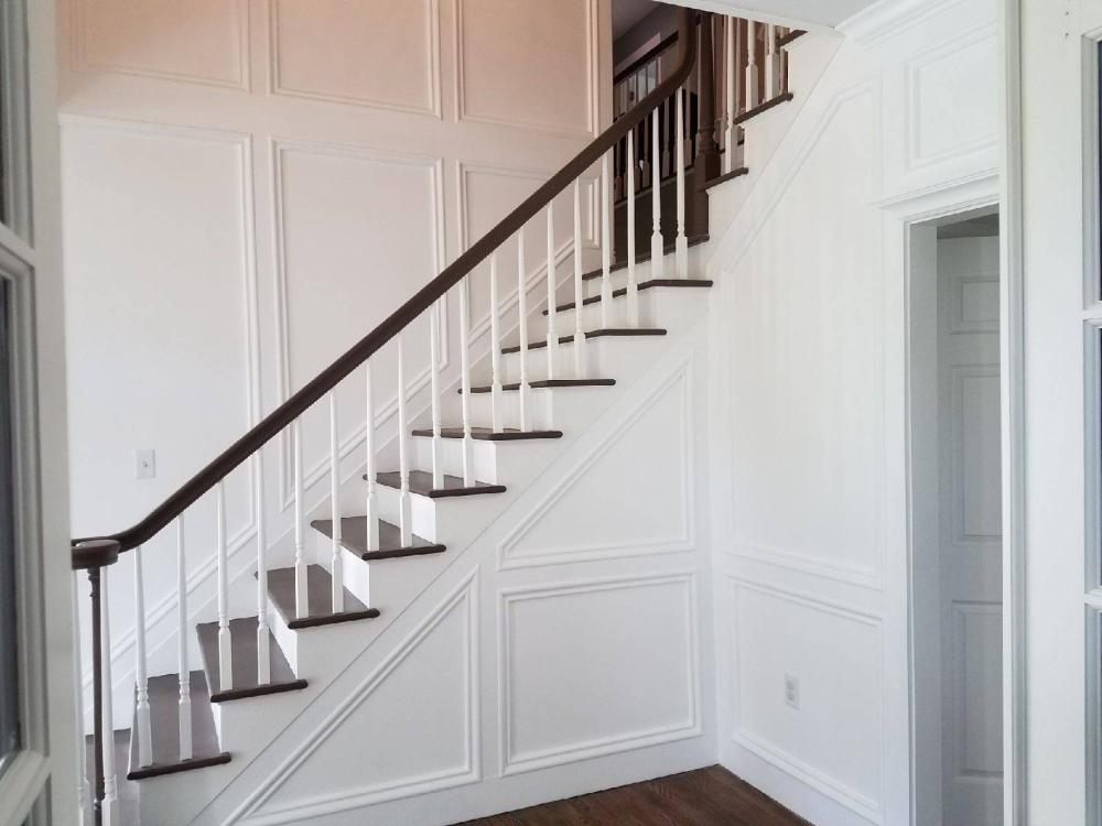 After #1 Custom carpentry moulding and trim added to two story staircase walls in Upper St. Clair PA