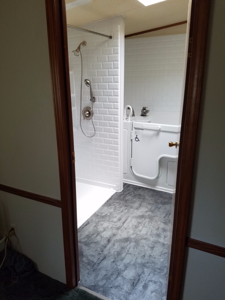 This remodel included the removal of a large corner tub and the installation of a safe, walk in tub plus a new shower.