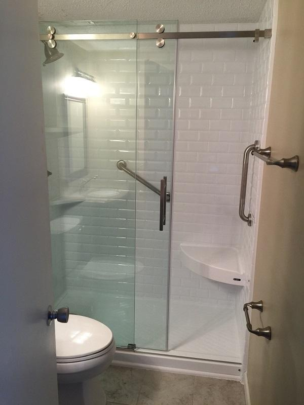 Melrose  Heights Condo.  White  Durabath Classic  Subway with a corner seat. Featuring a 3/8
