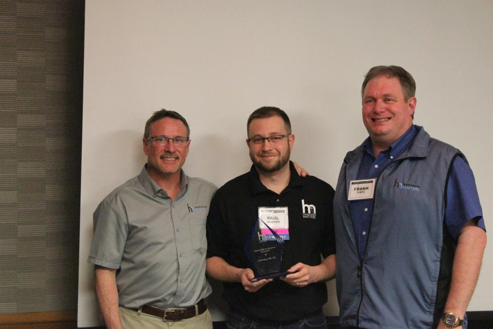 Owner Paul Hammer Receiving an Award  with Andy Bell and Frank Foti