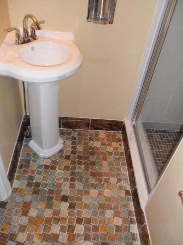 Pedestal sink and ceramic tile floor included in this bath remodel in Canonsburg, PA