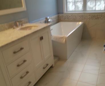 Bathroom Remodel-Floor tile, Vanity,Tub install, Painting, Trim-Frederick, Maryland