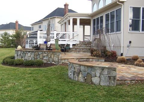 Covered deck and flagstone patio
