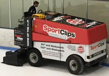 Apex Park & Rec commissioned SpeedPro Denver to wrap this Zamboni for sponsor Great Clips