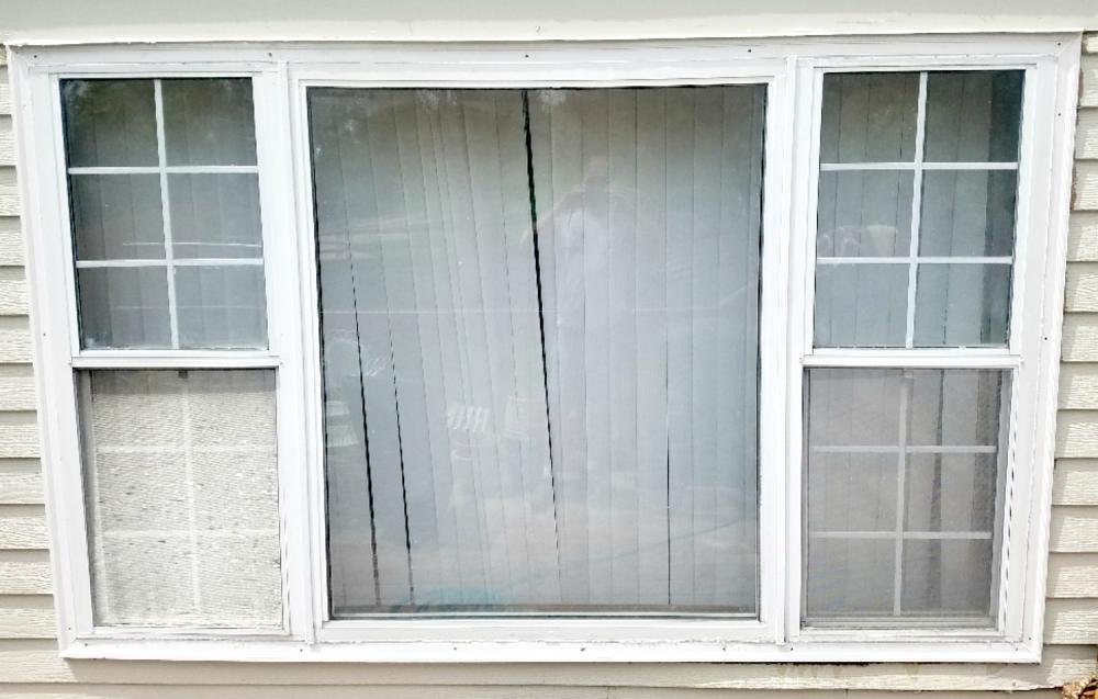 Before photo of exterior trim replaced around window in Littleton, CO
