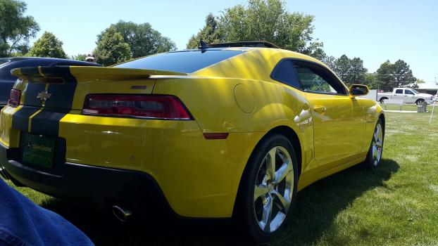 Who does the owner of this 2015 Camaro SS call, when he gets a rock chip?