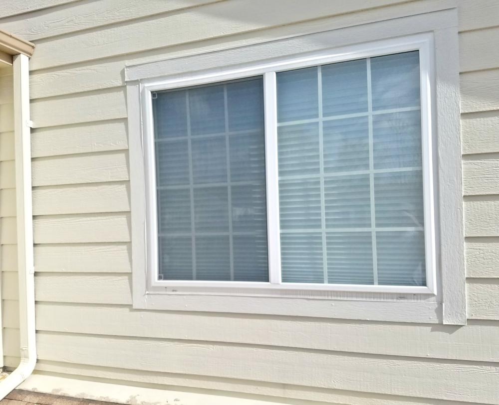 Before picture of siding replacement and window trim repair in Parker, CO