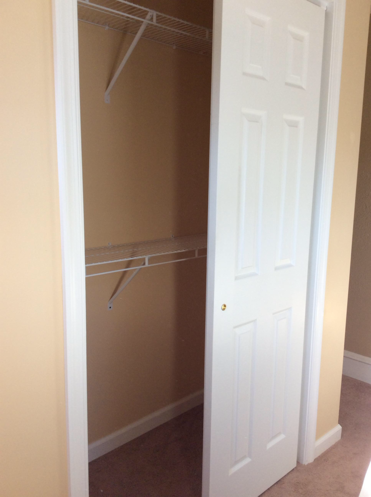 Closet Construction with By Pass Sliding Doors in Wyoming