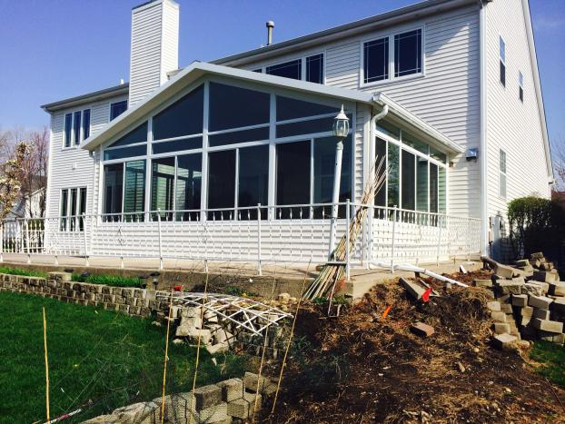 Cathedral sunroom with siding to match