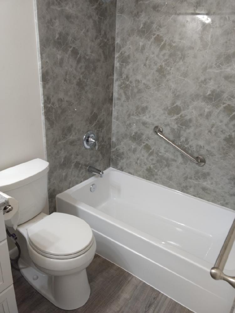We replaced the old tub with this new Re-Bath tub and wall system.  A new Moen faucet and grab bars added beauty and functionality.  A new floor, toilet and vanity completed the complete transformation..