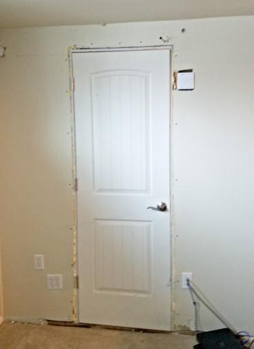 Remove Door & build solid  wall  in Cherry Hills CO 80113