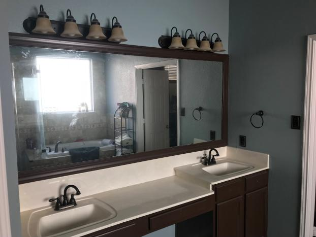 New vanity cabinets , lights, and mirrors installed in Master Bathroom