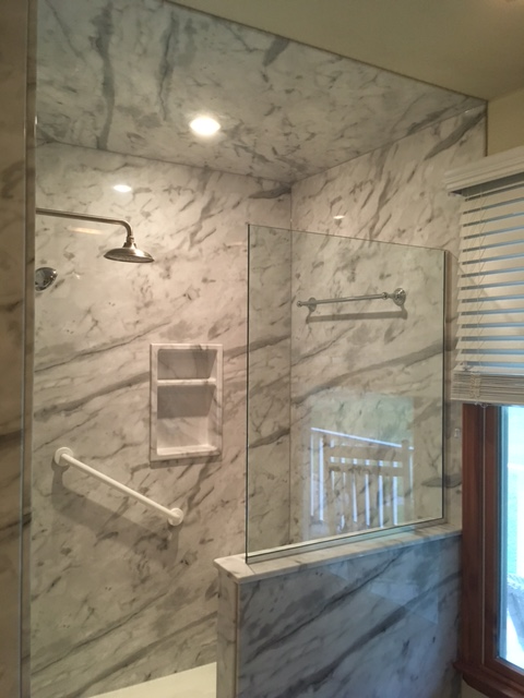 We took out the homeowners old fiberglass jetted tub and replaced with this beautiful walk in shower with rain head and bench seat.