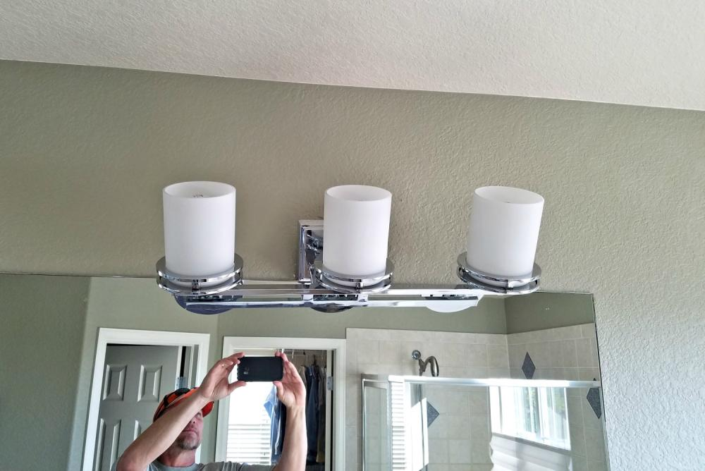 Before photo of new bathroom light fixture installed in Cherry Hills Village, CO