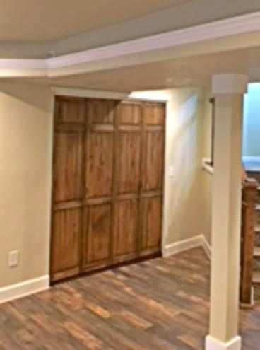 After photo of bi-fold doors installed to hide furnace room in Golden, Colorado
