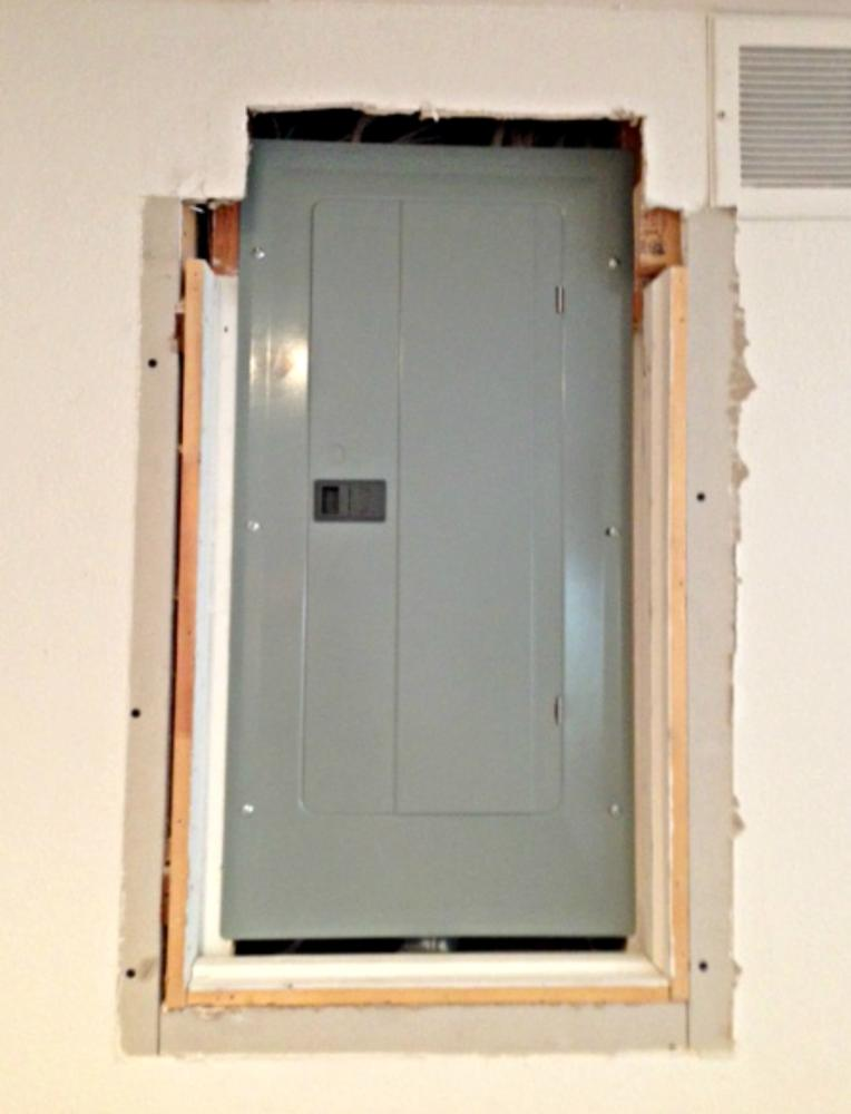 Custom build service panel access door in Castle Pines, CO - Before Photo