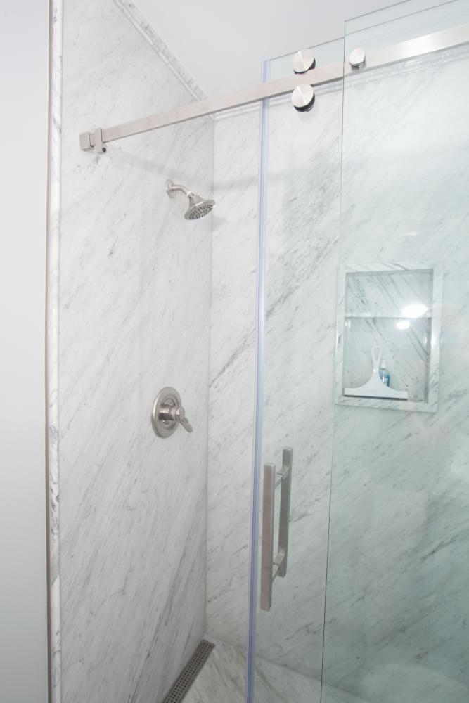 RE-BATH NATURAL STONE -WHITE CARRERA MARBLE WALLS,  RECESSED NICHE, ARIZONA SHOWER DOOR 3/8