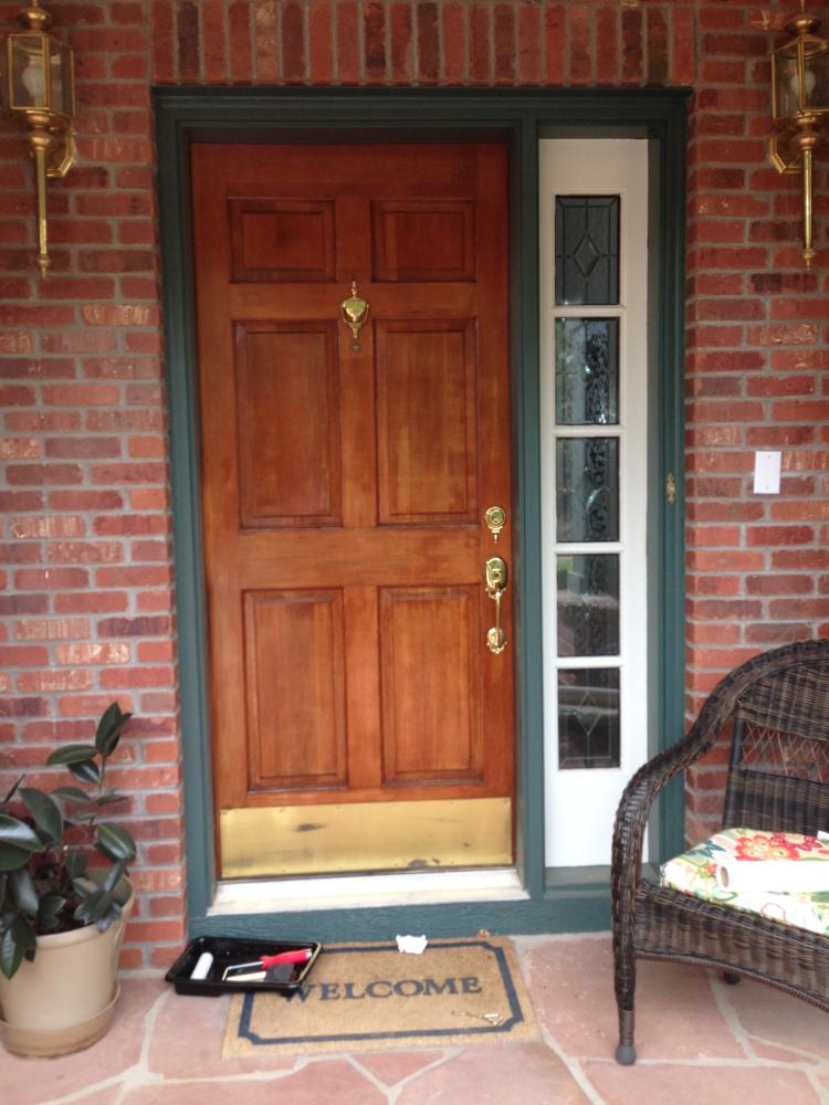 Painted trim and stain of entry Door in Greenwood village CO 80121
