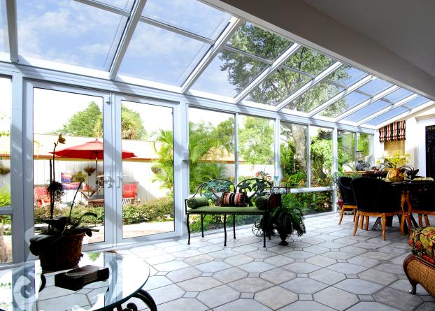 Rear Patio Home Extention Remodel Utilizing A Glass Roof For  Added Openess