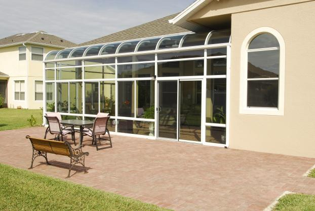 Custom Curved Glass Patio Deck Extension with Extra Height Front Wall Section