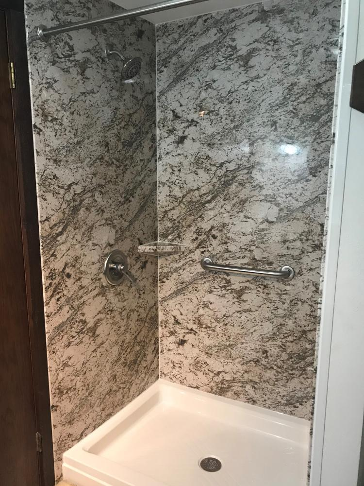 Rebath Biscayne walls gives this shower a new look.