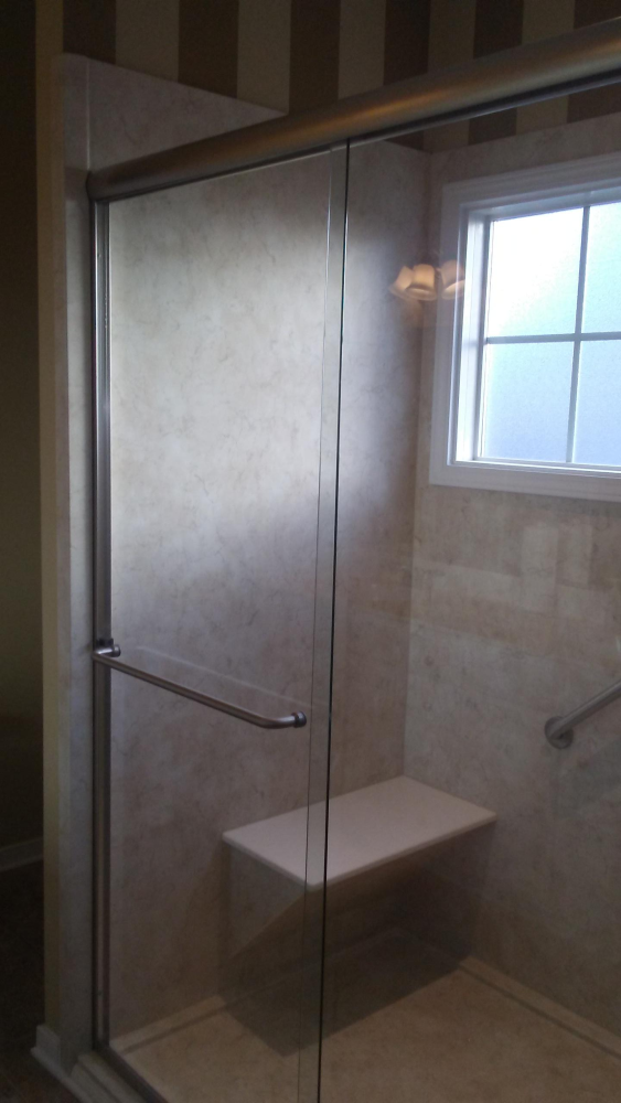 Re-Bath remodel in Chesterfield, VA turning a tub into a low threshold seated shower with window trim to protect the sill.