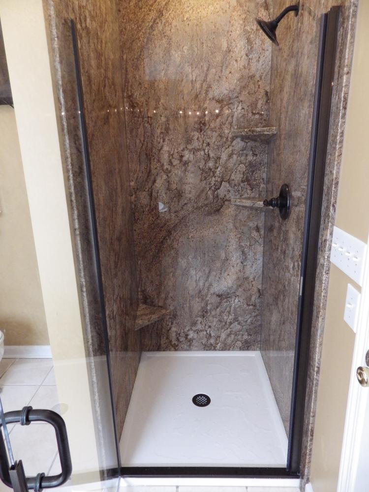 Removed small gelcoat shower and installed new DuraBath SSP shower