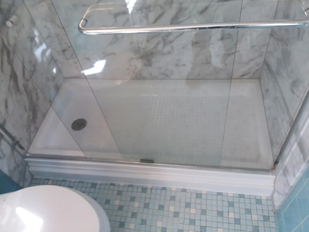 This tub to shower features sliding bi-pass glass doors.