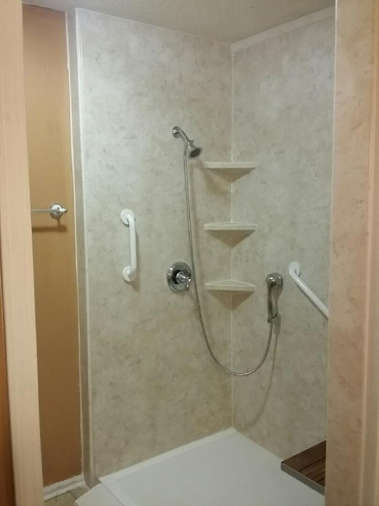 The new shower has an easy to walk in, barrier free threshold.  Installed in Dothan, AL.