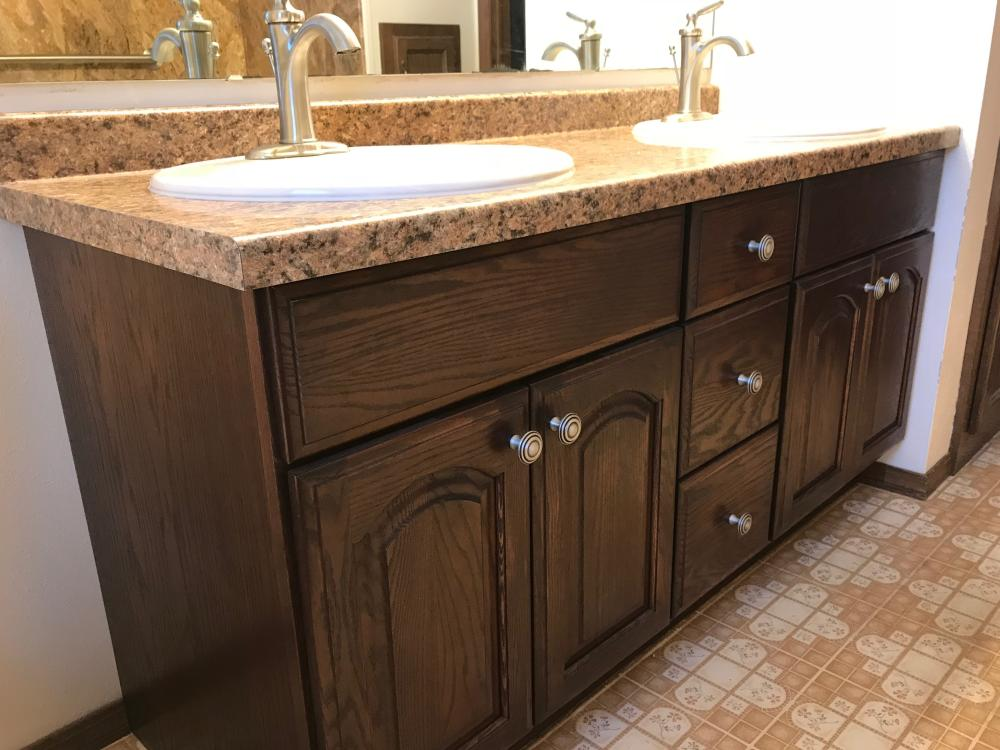 New vanity, counter-top, sinks and faucets gives this bathroom a fresh look.