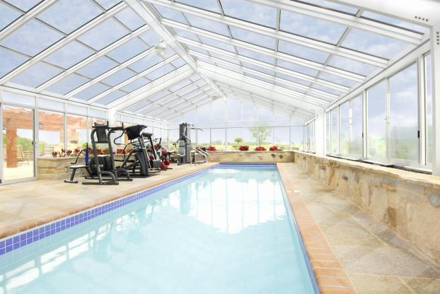 Pool enclosure with exercise area