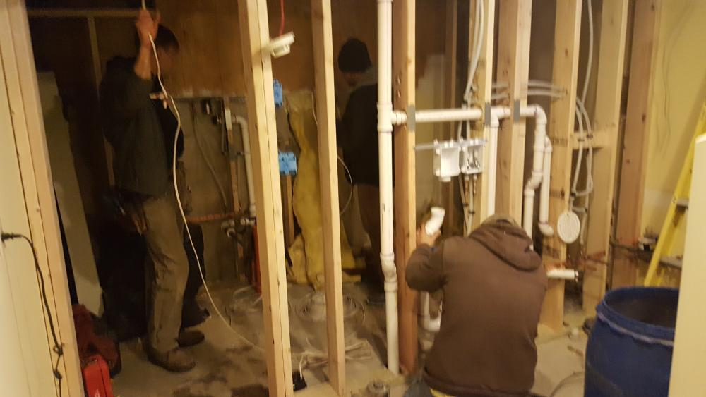 Installing plumbing and electrical in the dividing wall between the new bath and laundry