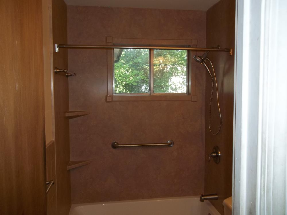 Trim kit protects the window sills.  Durabath walls and handheld makes this an easy to clean tub and shower combination.