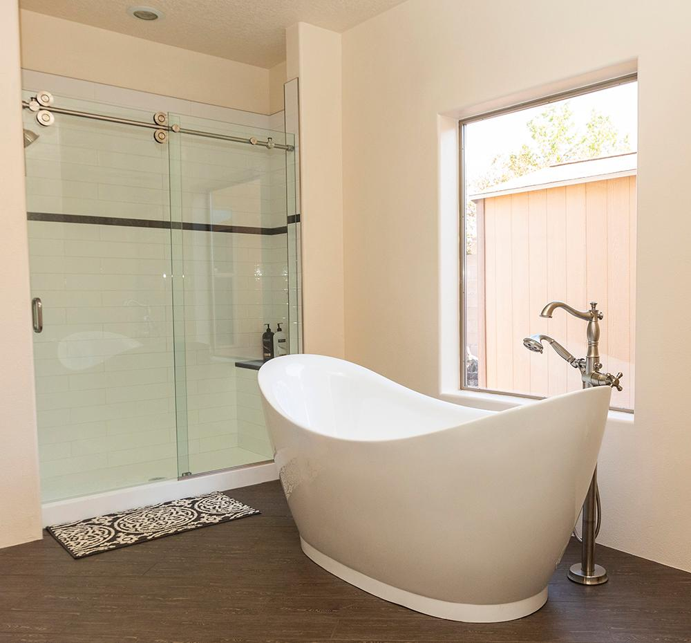 Free standing bathtub added to this master bathroom, for an elegant look. Remodel completed in Albuquerque, NM.