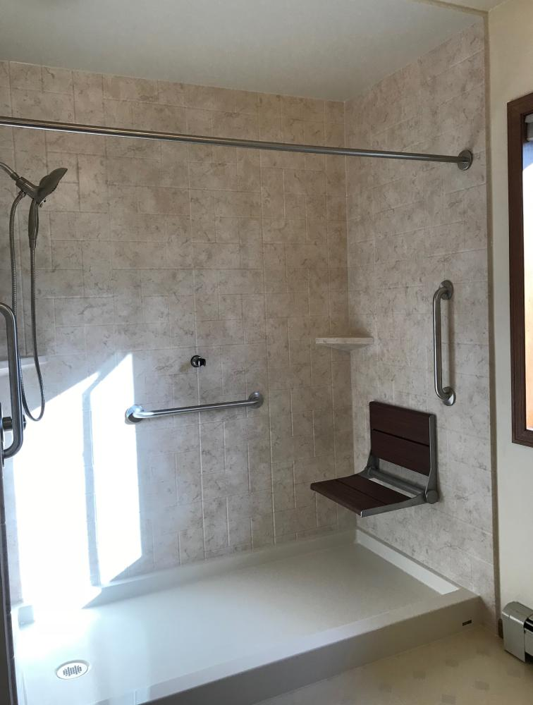 Tivoli Travertine Matte Newport Simulated tile walls with a biscuit shower base and ceiling.  Also,  includes an In2uition shower head with an Invisia seat.  Fixtures all in stainless steel.