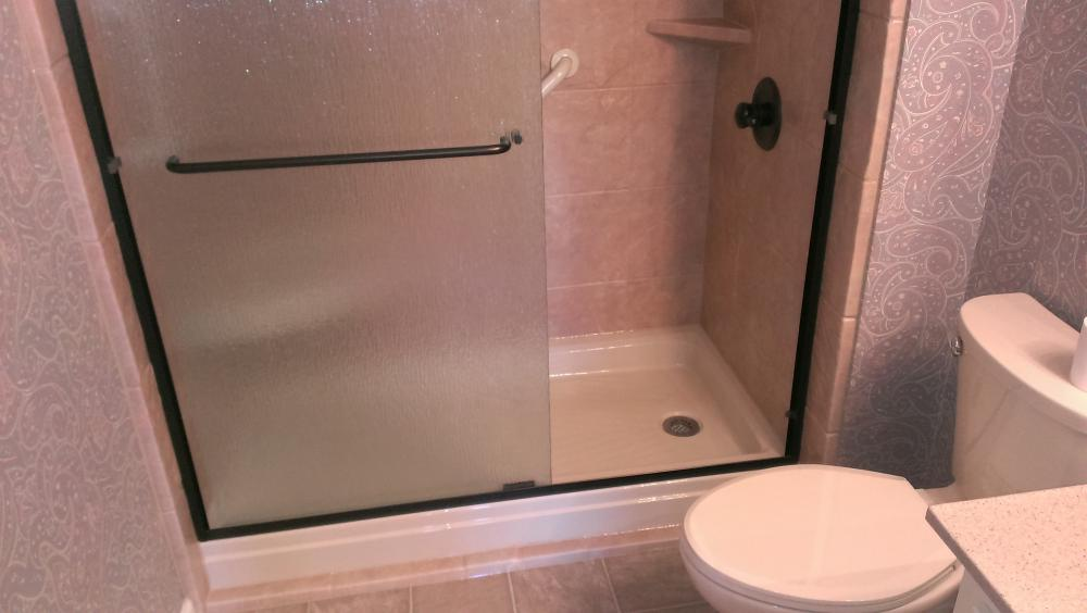 Tub to shower update is clean and modern. Installed near Geneva, AL.