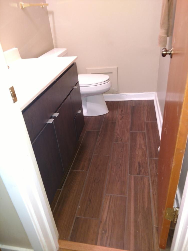 Re-Bath complete bathroom remodel to include vanity and tile flooring in Midlothian, VA