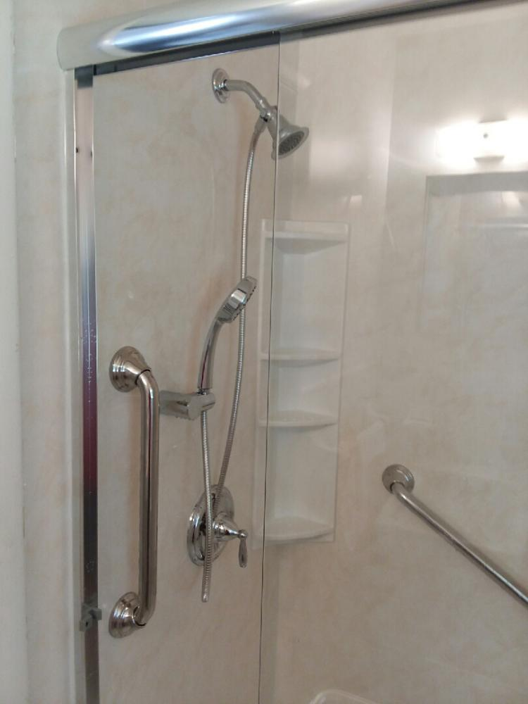 Tub/Shower converted to Shower featuring hand held and safety bars in Lanett, Al