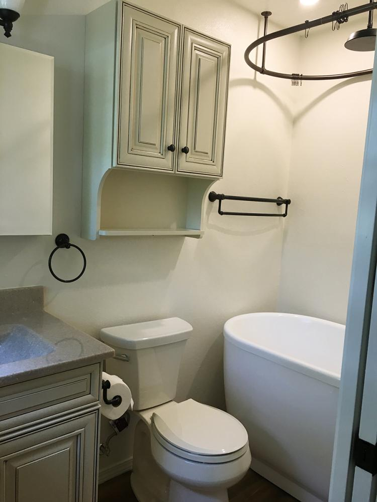 In this remodel, we switch the location of the toilet and the vanity, added a modern free standing tub and installed a wrap around ceiling shower curtain that give this bathroom an industrial feel. Completed in Albuquerque, NM.