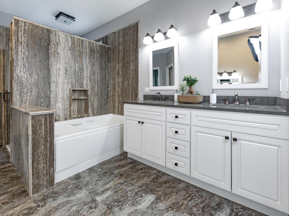 Natural stone full bathroom remodel