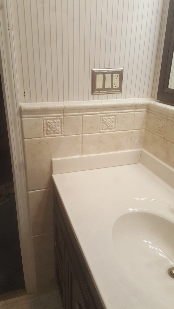 Wainscot can be available in a simulated tile patter or even bead board look.  Installed in Dothan. AL