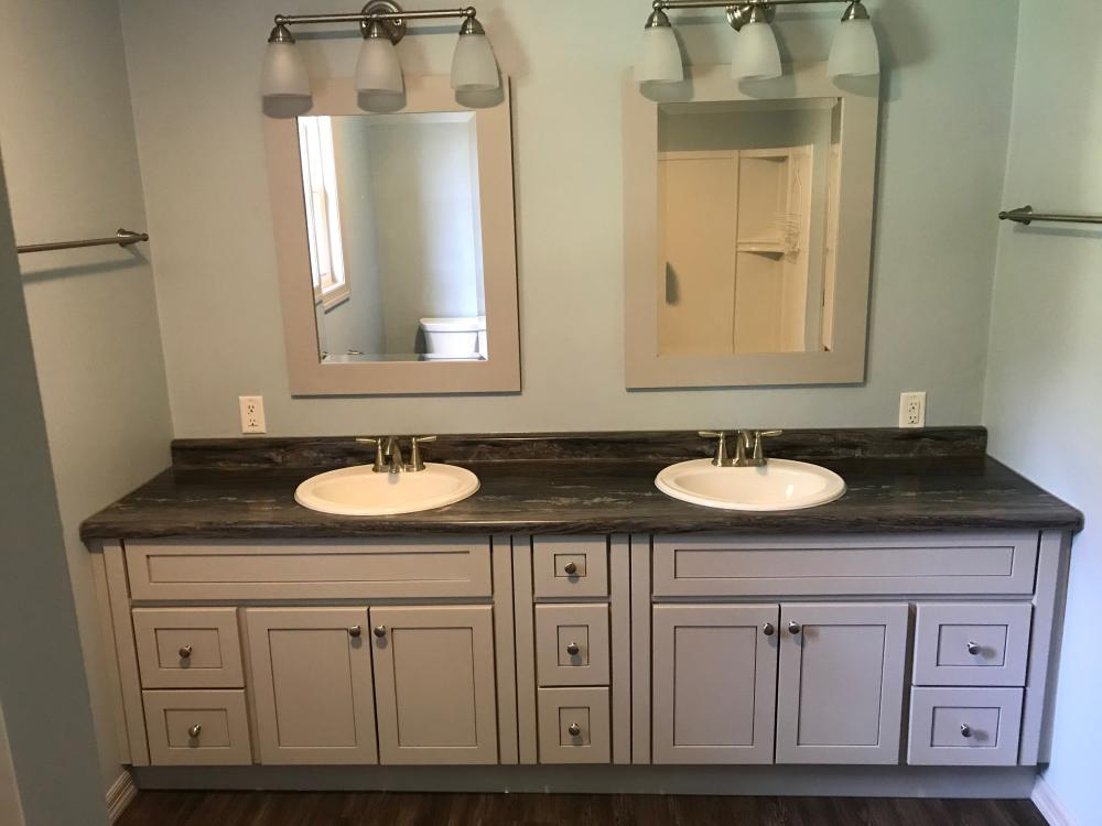 Premium build Bertch vanity with birch wood, lighthouse gray paint with a matte finish. Formica laminate Black Fusion vanity top with 3