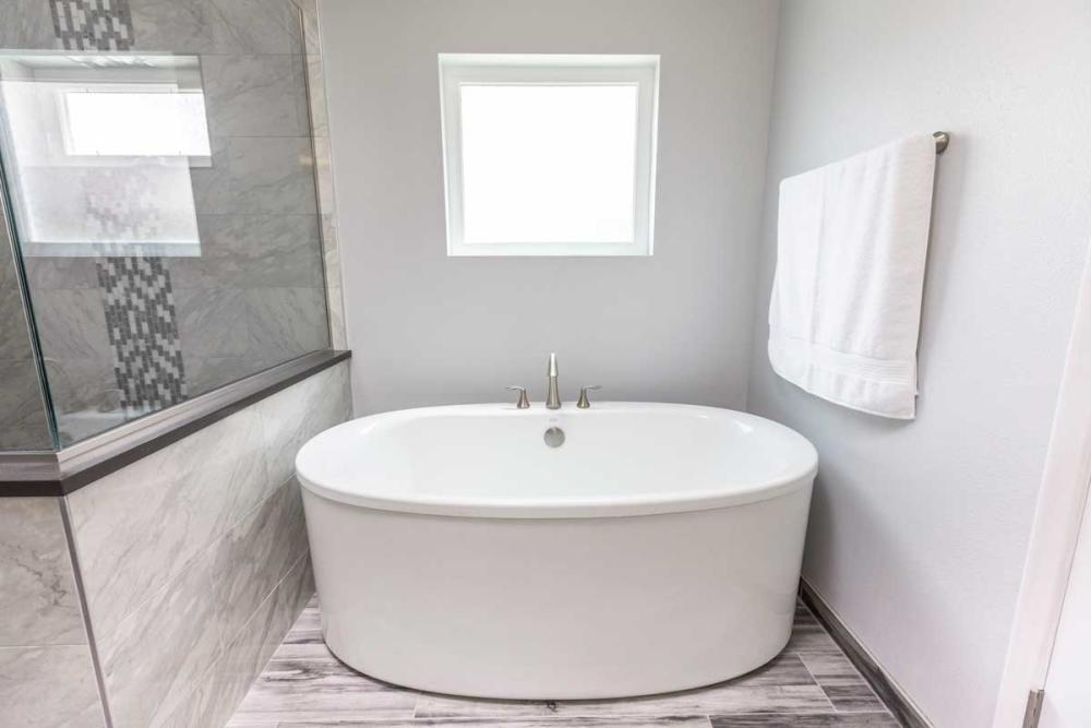 We added a modern freestanding bathtub to complete the look of this elegant master bathroom.