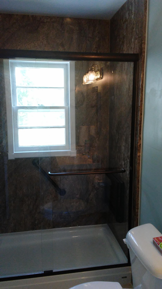 Enlarged shower by removing linen closet