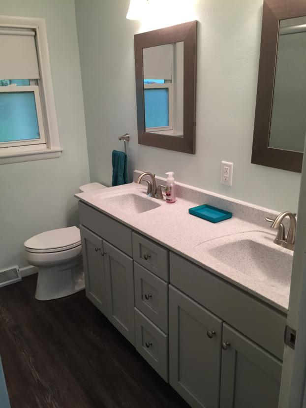 Bertch Premium build Osage design vanity with Oasis Cultured marble Galena small particle top with matte finish and 2 rectangular recessed  bowls. Kohler highline elongated toilet and Luminations Supreme Versa Luna luxury vinyl flooring.