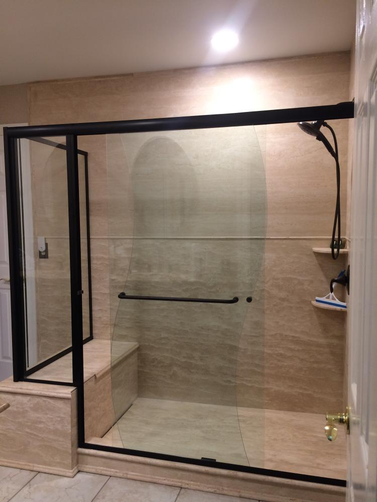 Richmond, Virginia customer went from a soaker tub to a seated shower.  All Natural Stone with a linear drain.