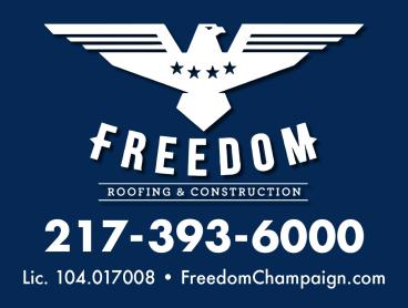 A yard sign for a roofing & construction company