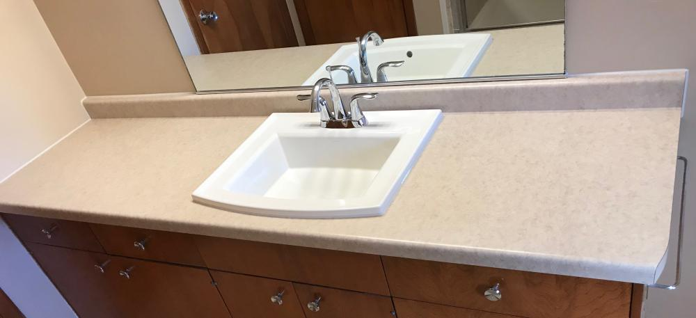 Formica Vanity Top with standard backsplash in a Natural Canvas Matte color with a Kohler Archer rectangular sink and Chrome fixtures